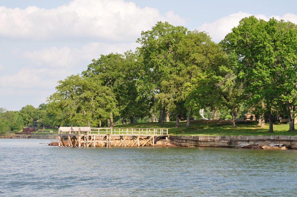 dock as seen from the water on lake bob sandlin in east tx state park