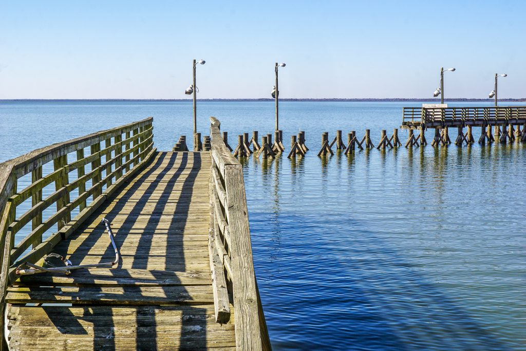 wooden dock leading out over cooper lake, one of the best east texas state parks