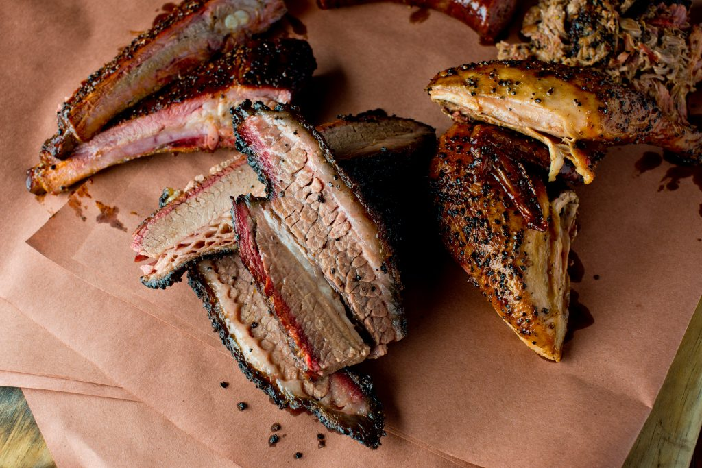 collection of pork spare ribs, a popular texas bbq dish, on butcher paper