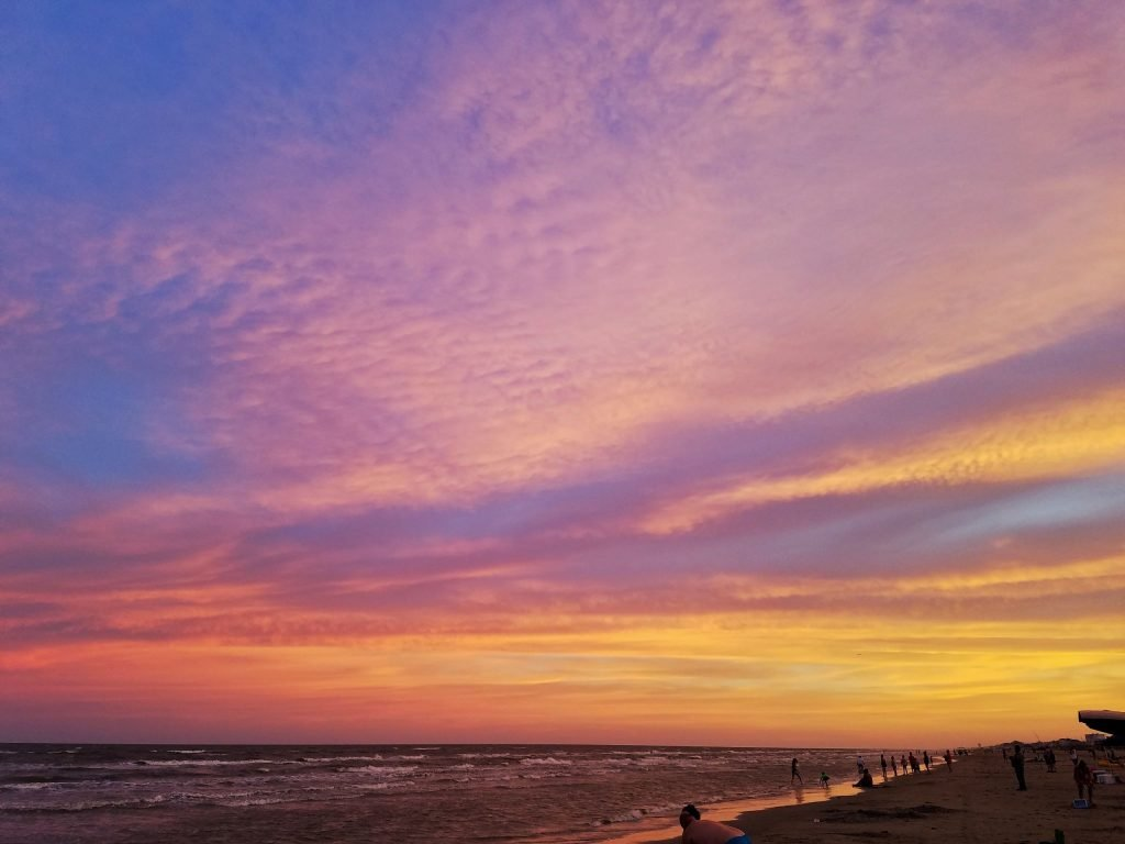 dramatic sunset at jamaica beach, one of the best beaches in galveston texas