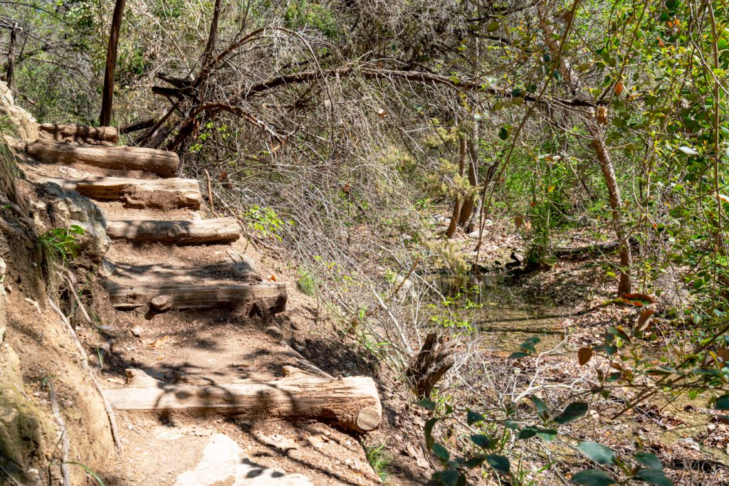 wooden steps running along a cliff edge in river place hike