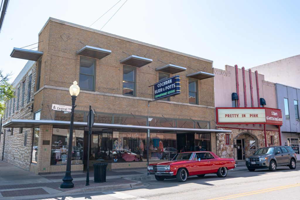 cochran blair and potts department store in belton texas with a red car parked out front