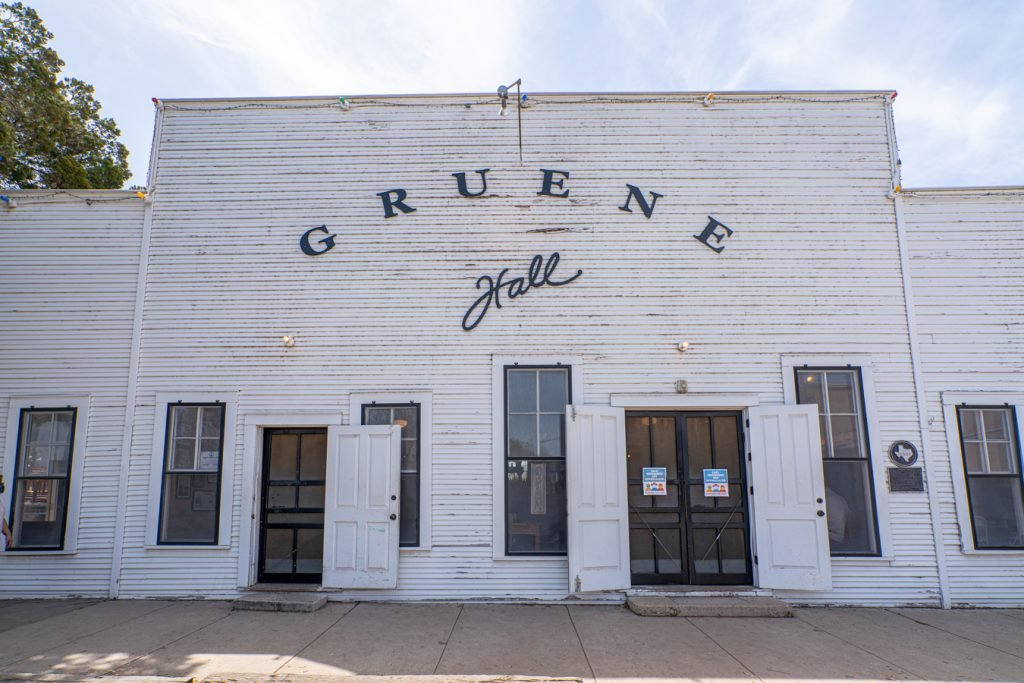 front facade of gruene hall, one of the best things to do in gruene texas