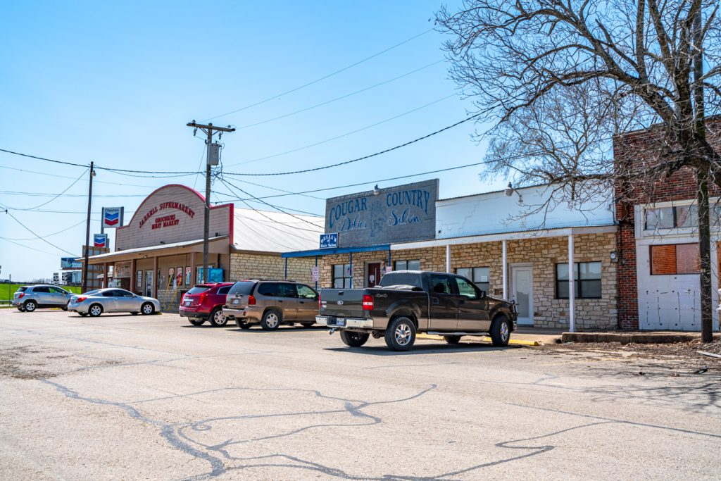 downtown jarrell texas storefronts with cars parked out front