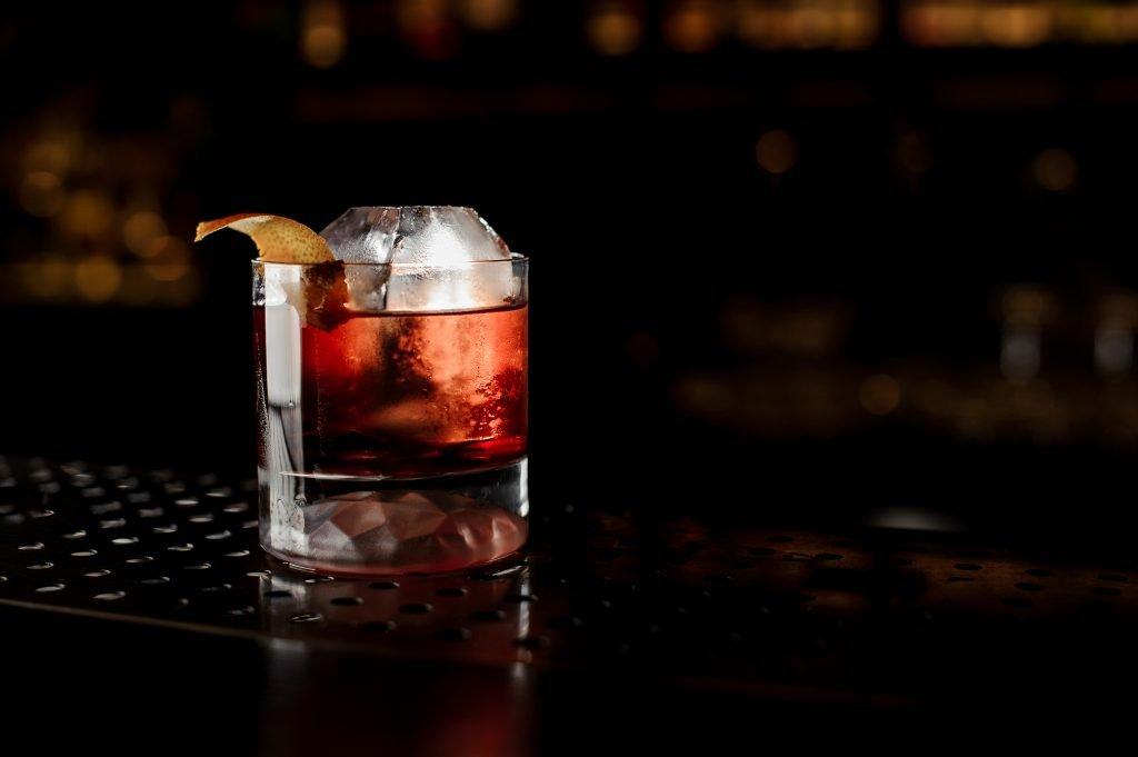 mixed drink sitting on a dark bar