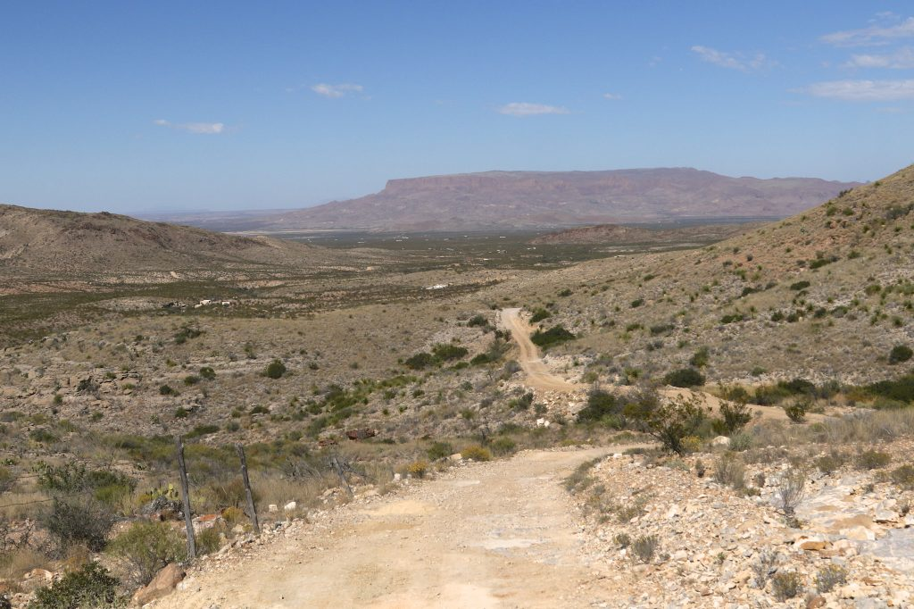 isolated dirt road leading to christmas mountains in texas