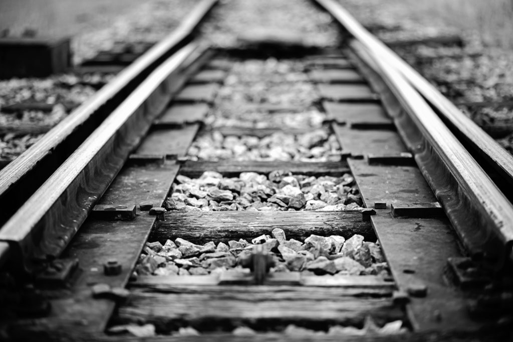 black and white photo of texas haunted railroad tracks