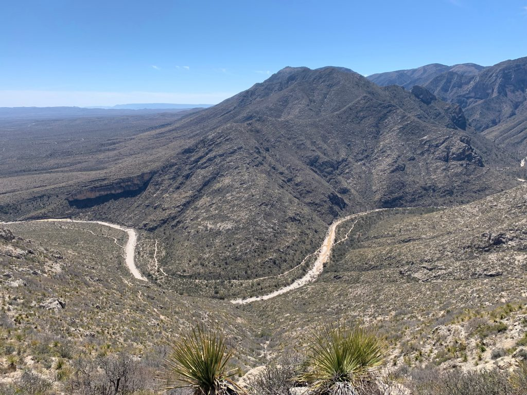 texas mountains as seen from above with a curving road through the center