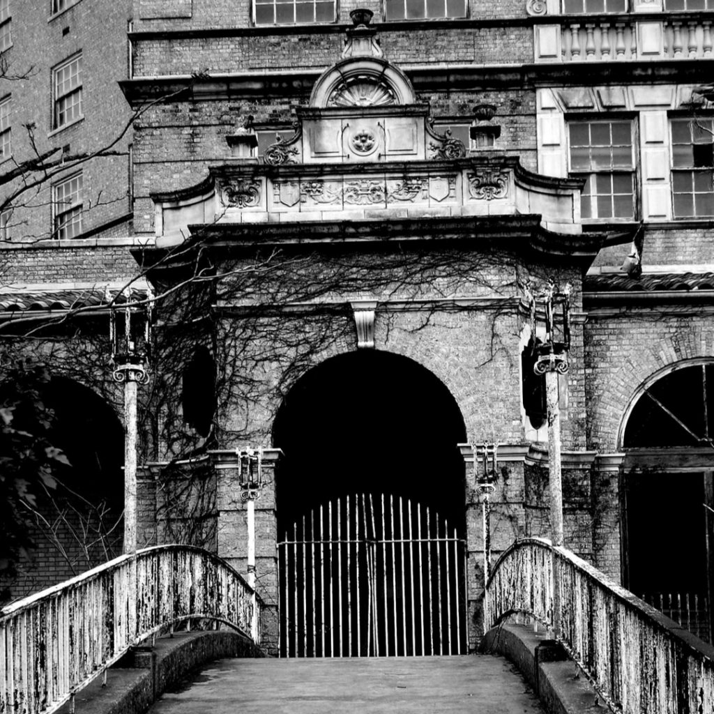 black and white photo of elaborate doorway to baker hotel, one of the most haunted locations in tx
