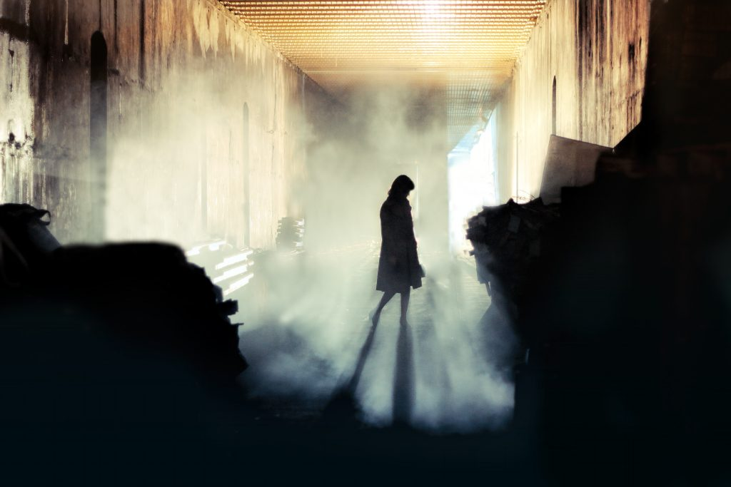 silhouette of a woman in a scary hallway