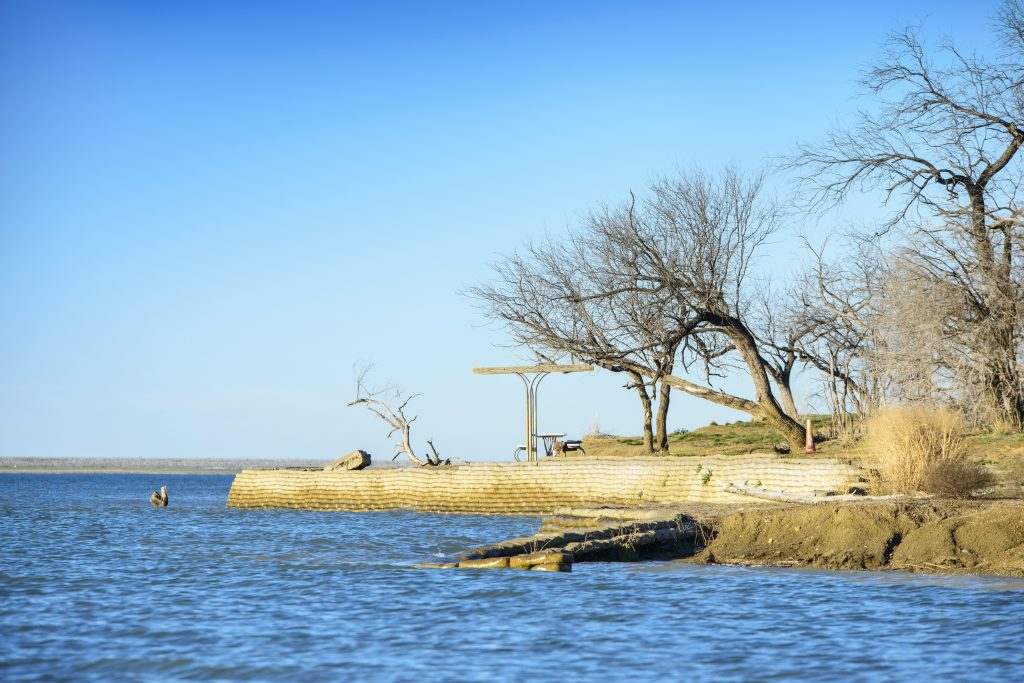 rocky shore of cedar hill state park as seen from the water
