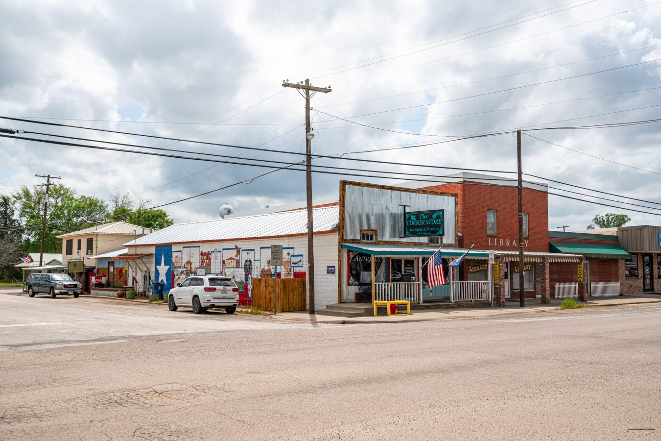 shops in downtown centerville texas with a mural visible on one side