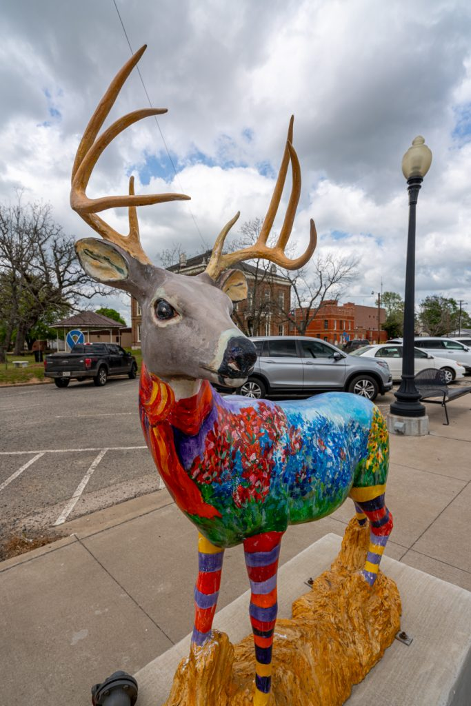 colorful painted deer statue in centerville texas