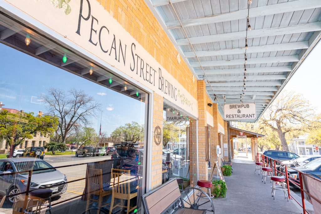 front facade of pecan street brewing, one of the best places to visit in johnson city tx