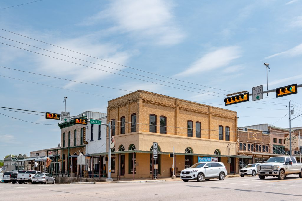 one of the major intersections in llano tx, with traffic lights visible in the foreground