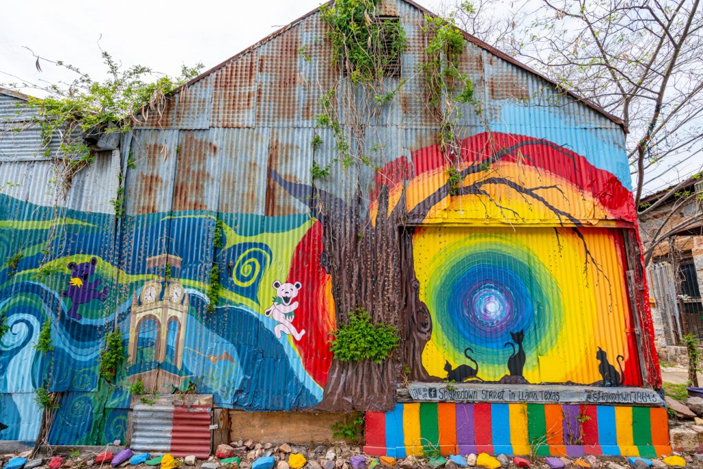 colorful murals in shakedown street, one of the best places to visit in llano tx