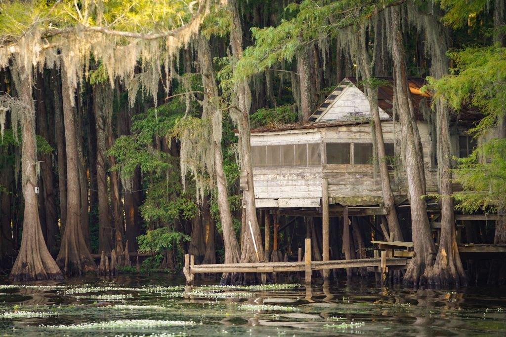 small abandoned white building overlooking tx caddo lake