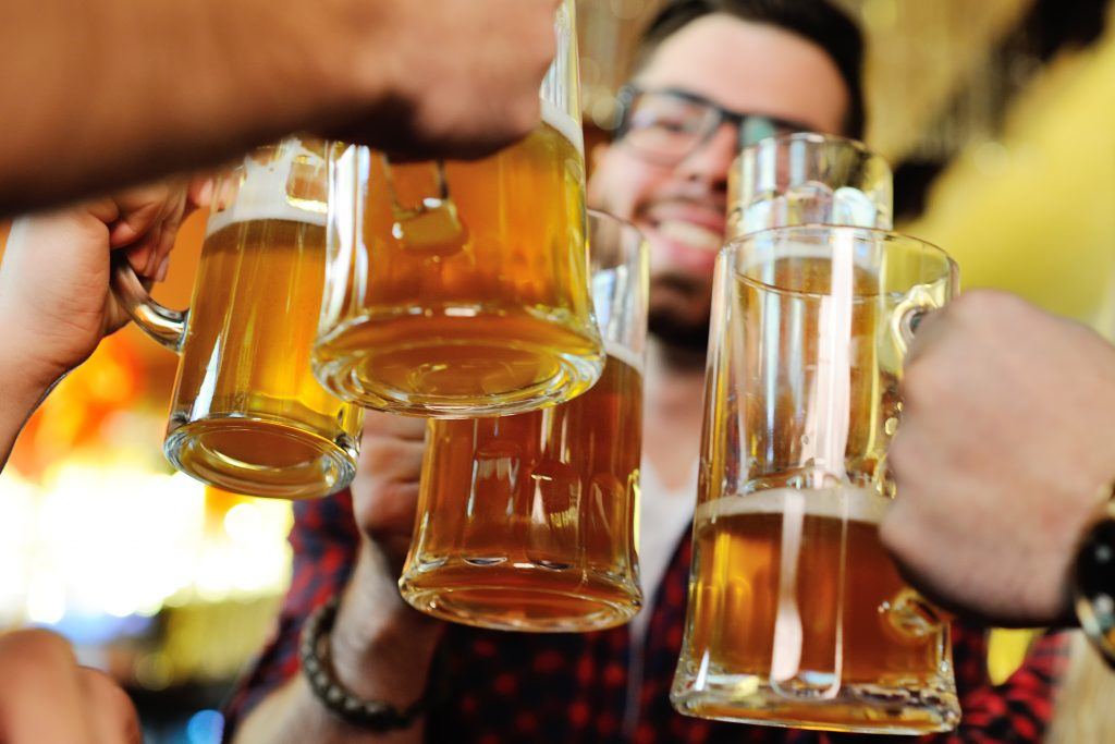 colletion of friends toasting with beer steins