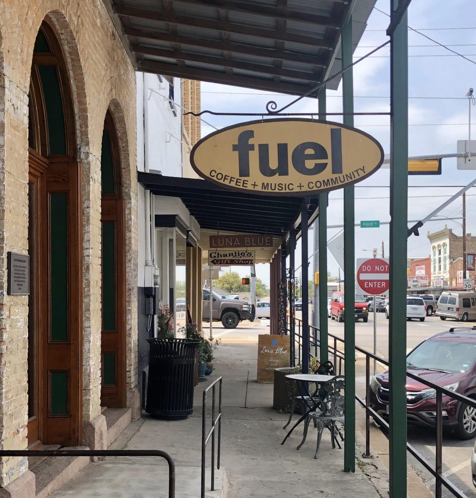 exterior sign of the fuel coffee house, one of the best places to visit in llano, with traffic in the background