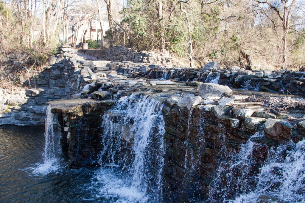 dallas waterfalls running over a stone formation