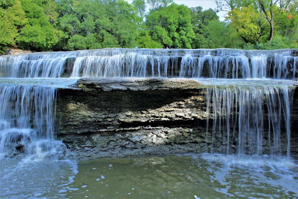 wide fort worth waterfall on a sunny day