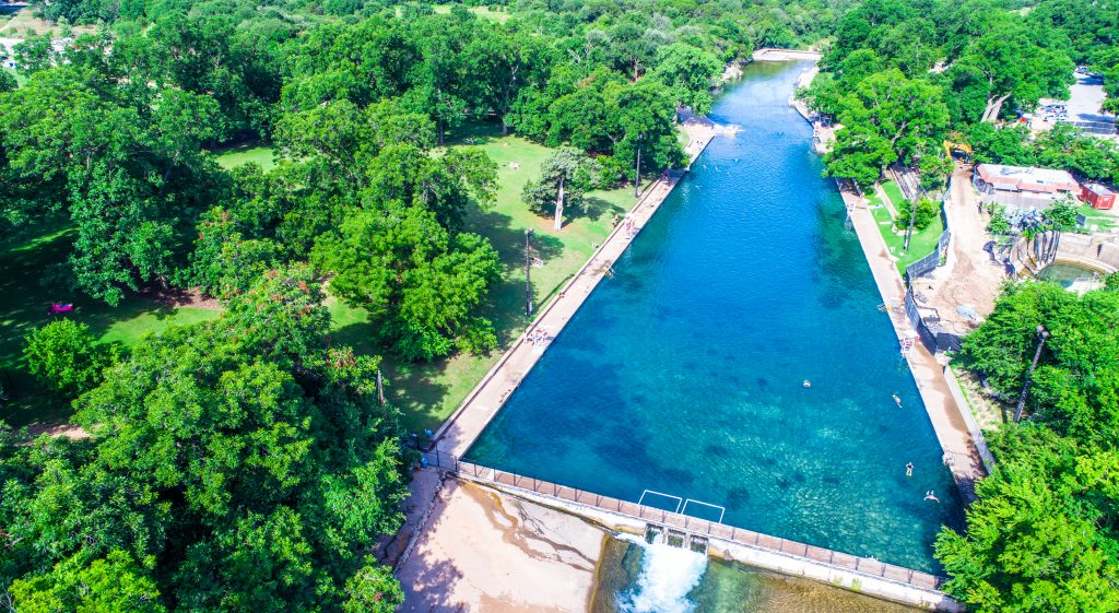 aerial view of barton springs pool, one of the best texas swimming holes
