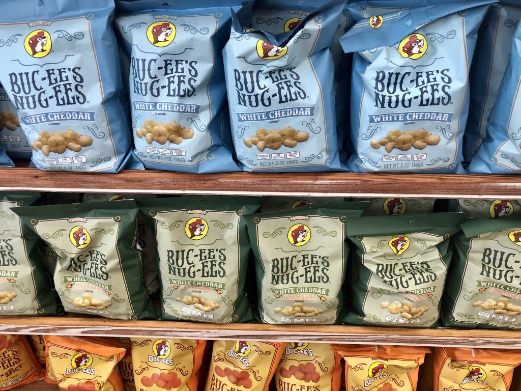 shelf of buc ees nug ees for sale in different flavors