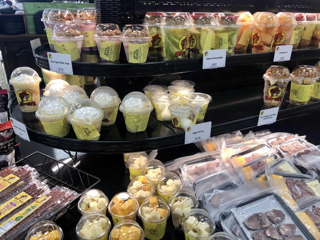 refrigerated case of food buc ee's including fruit and sausage