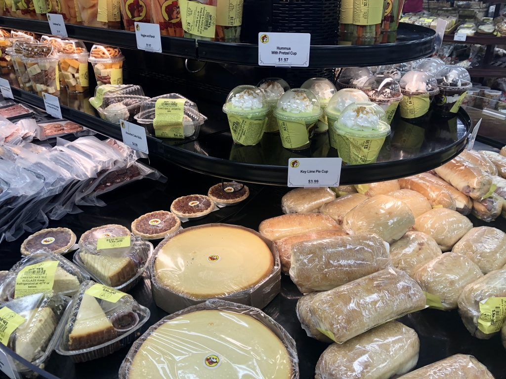 display case of buc ee's food including cheesecake