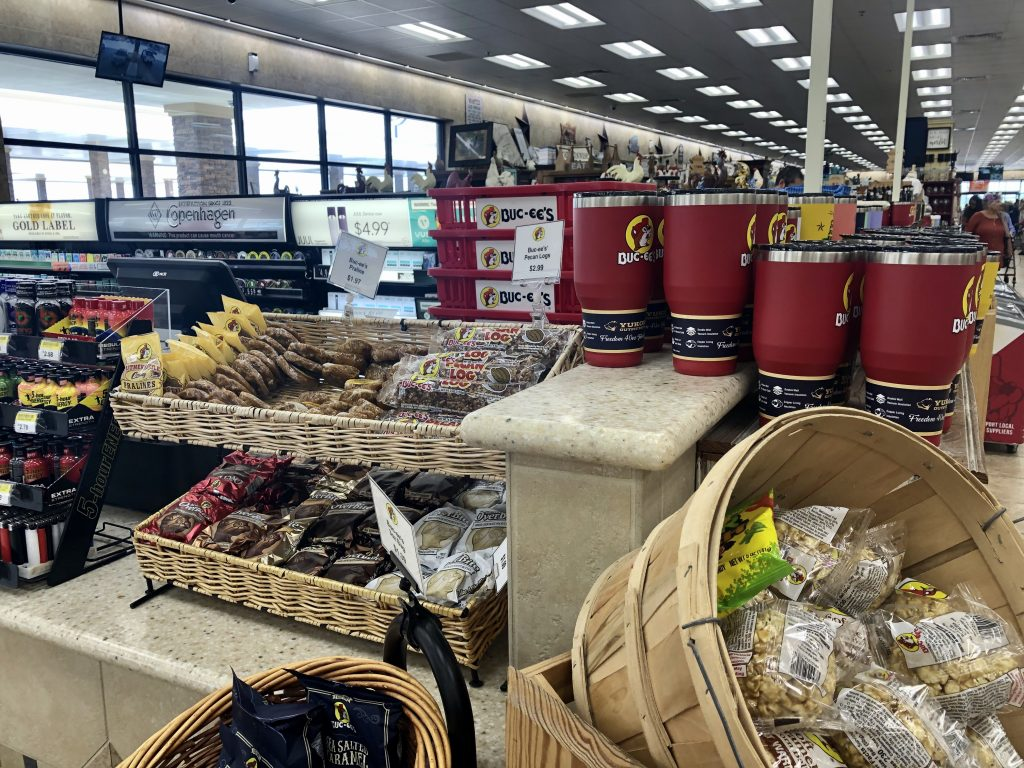 small display case selling pralines and other sweet treats by bucees checkout counter