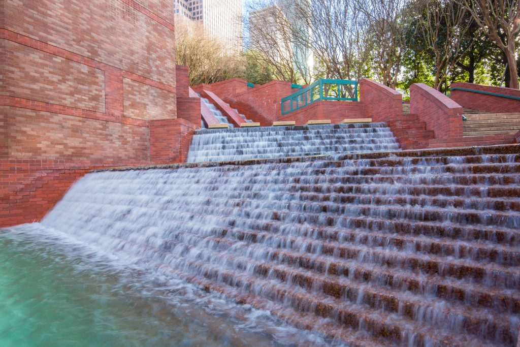 close up view of Sesquicentennial Park waterfalls in houston tx