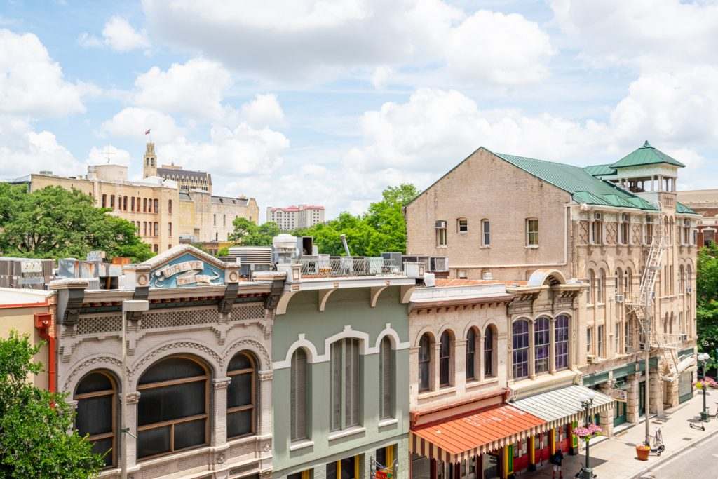 rooftops of historic buildings in downtown san antonio quotes
