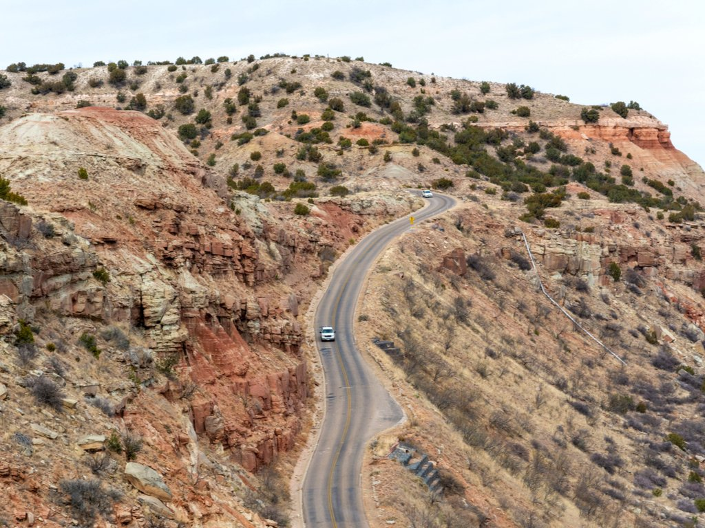 aerial view of scenic road in palo duro canyon, one of the best day trips from amarillo tx