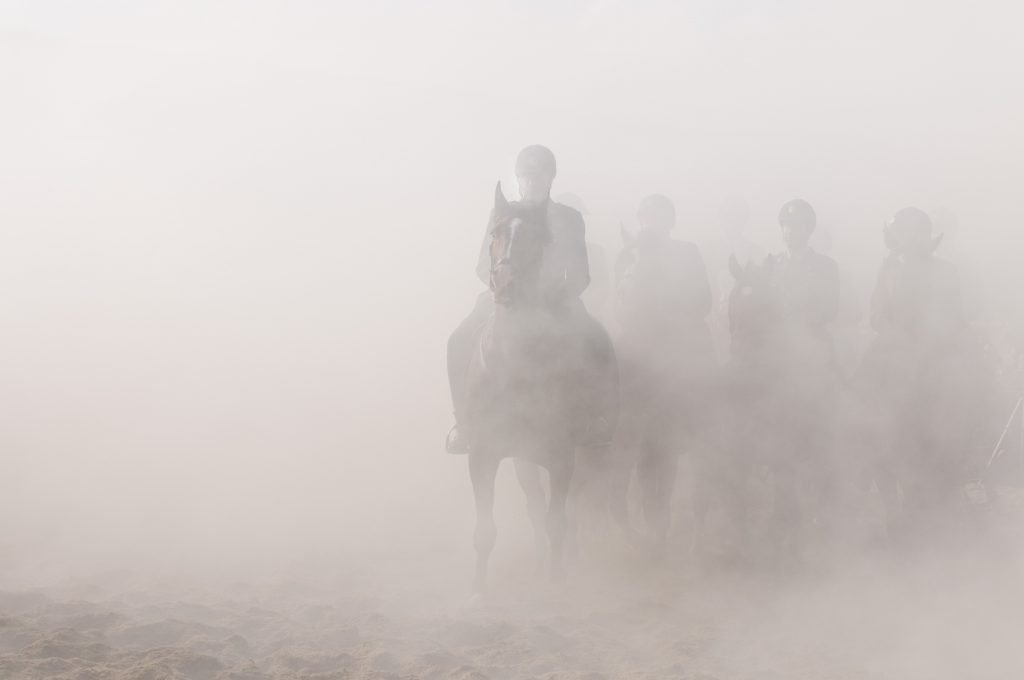 indistincy ghostly horses with soldiers riding them