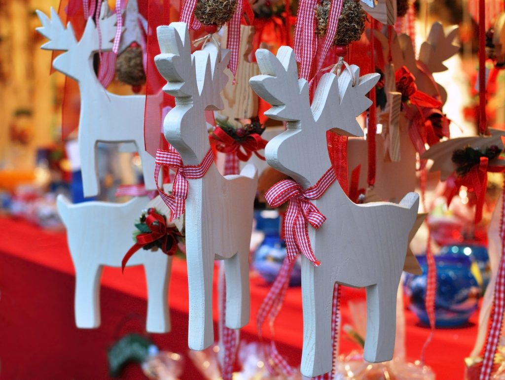 wooden reindeer ornaments for sale at a christmas gift market