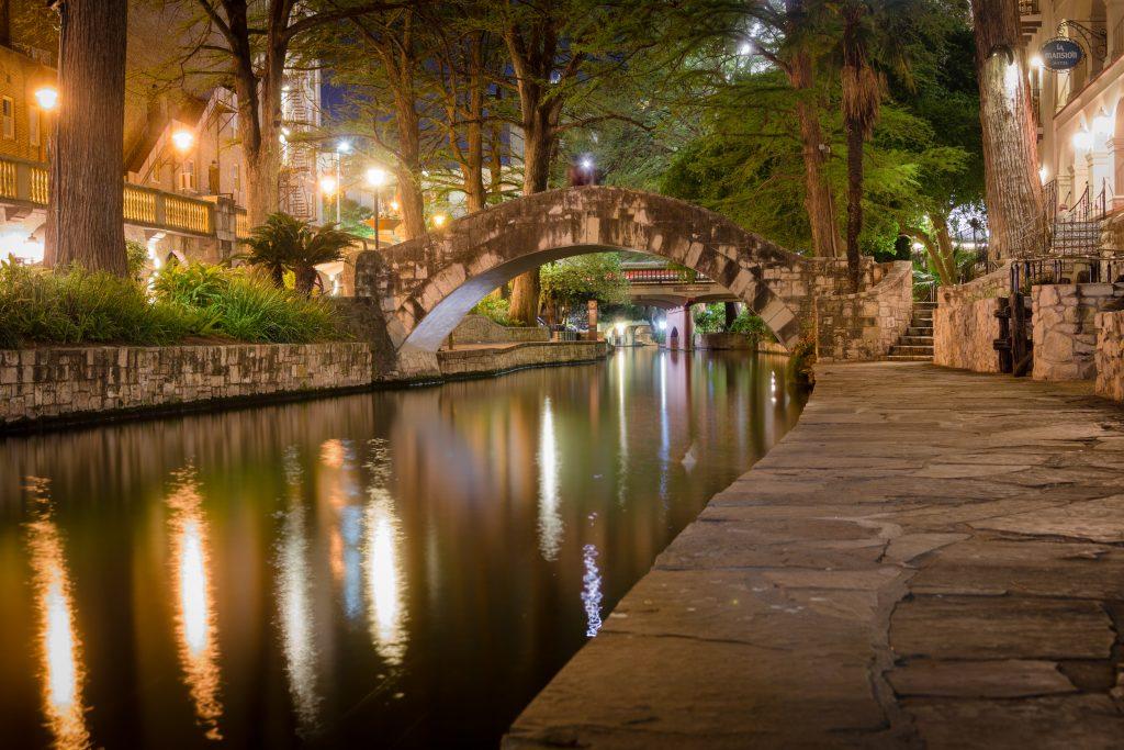 view of river walk san antonio at night