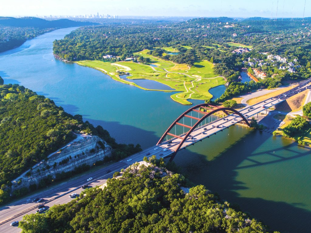 aerial view of lake austin and pennybacker bridge, one of the best austin lakes