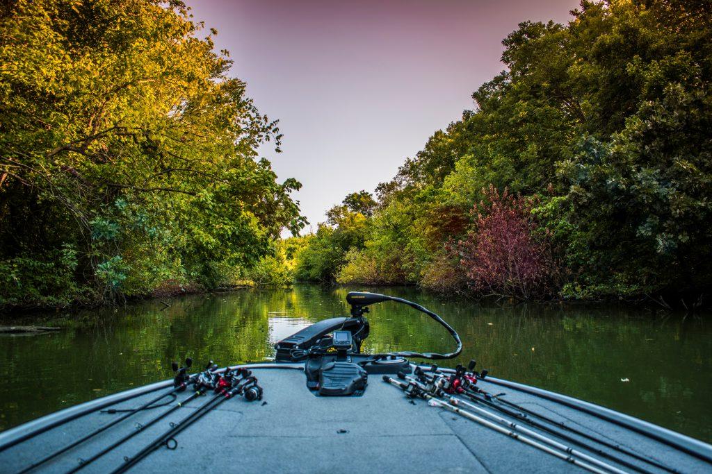 bass fishing boat amongst the trees at lake ray hubbard, dallas lakes