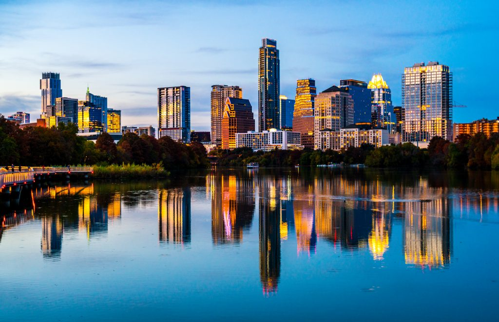 view of austin skyline at blue hour--night is the best time to discover haunted places and urban legends in austin