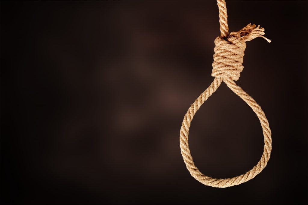 rope noose dangling from the ceiling