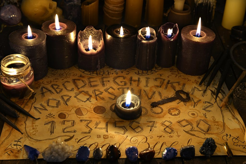 ouija board set out with candles