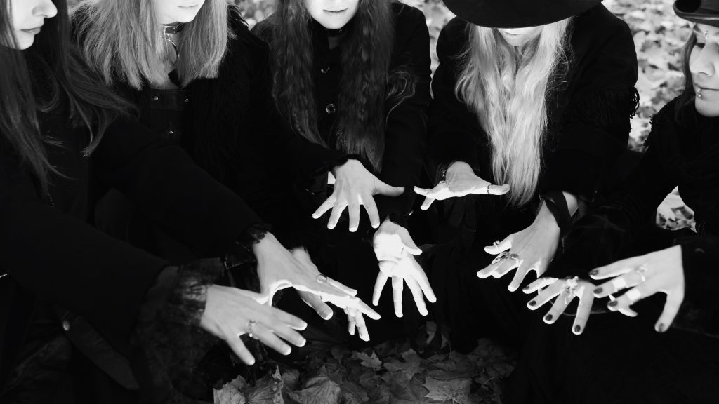 black and white photo of spooky chanting witches, dallas haunted houses