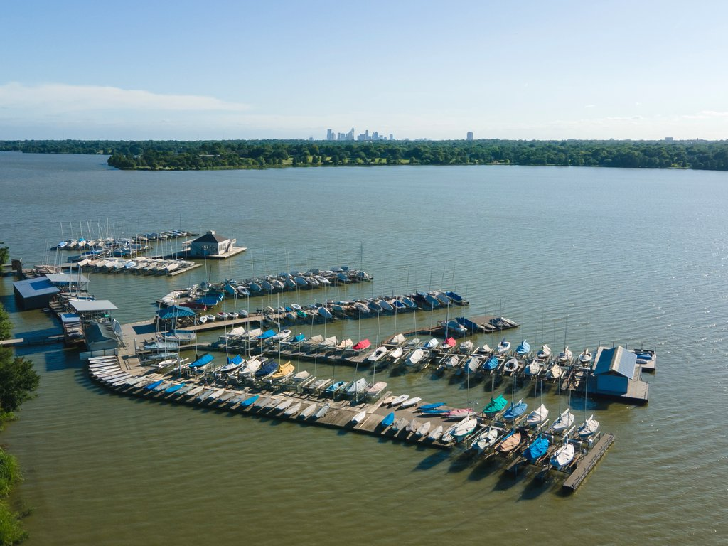 aerial view of marina at white rock lake, one of the best dallas lakes, with skyline visible in the distance