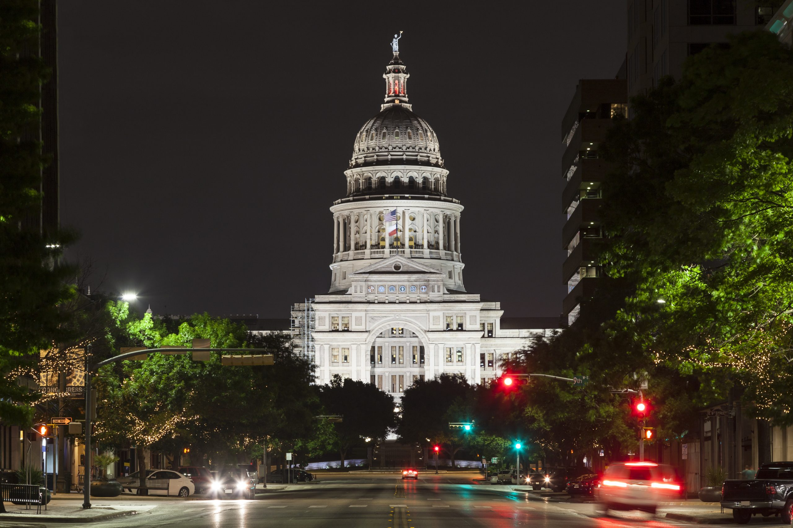view of texas state capitol building from congress street at night, one of the most haunted places in austin tx