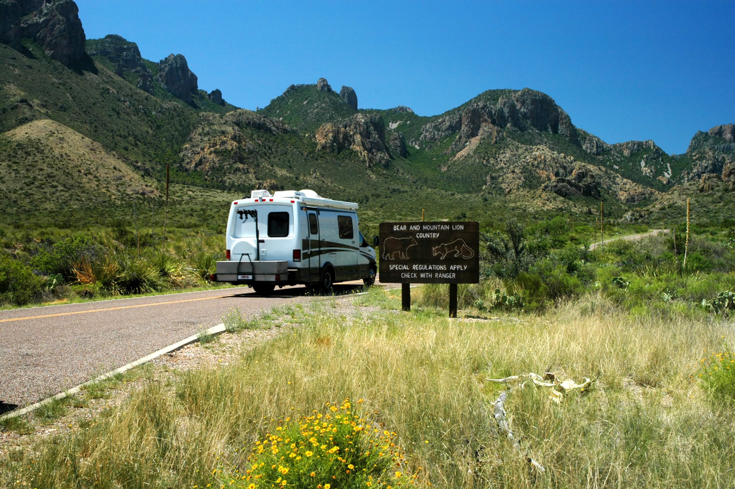 small white rv in big bend np driving to one of the best rv parks near big bend national park