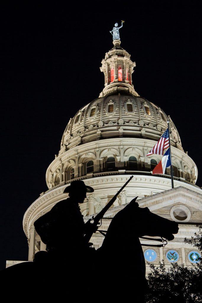 exterior of texas state capitol dome at night, one of the most haunted austin locations