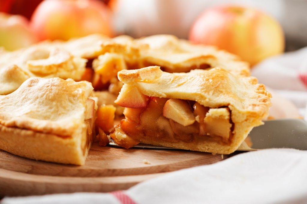 photo of a homemade apple pie seen from the side