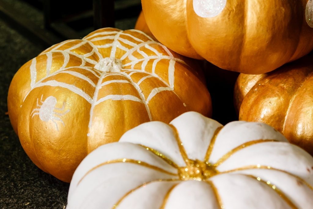collection of beautiful painted pumpkins, white and gold