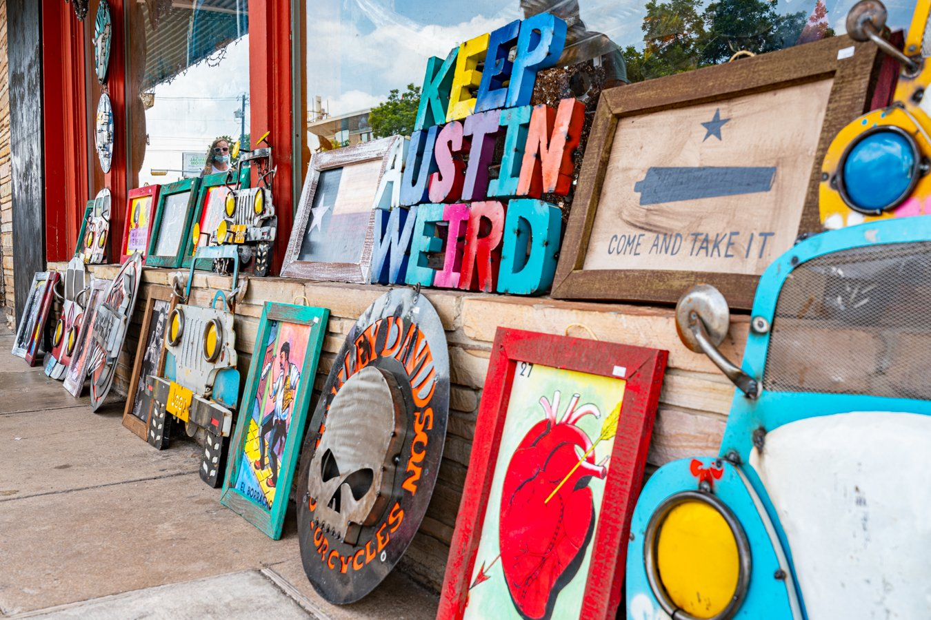 collection of art for sale on south congress, including a keep austin weird sign, one of the best quotes about austin texas