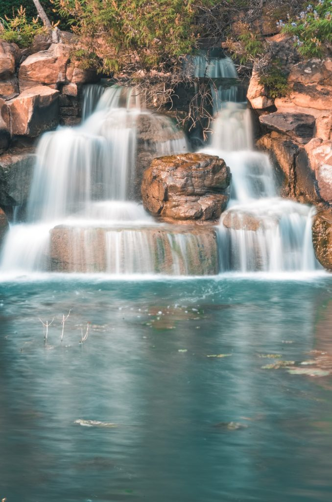 long exposure of a waterfall in frisco central park, one of the best things to do in frisco texas